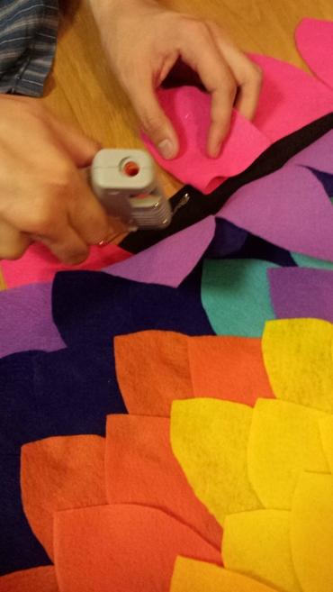 hot glue gun feathers to cape