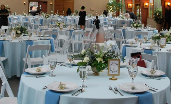 blue, gold, and greenery theme wedding table setting