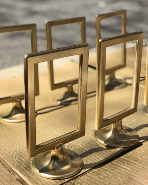 gold spray painted ikea tolsby frame